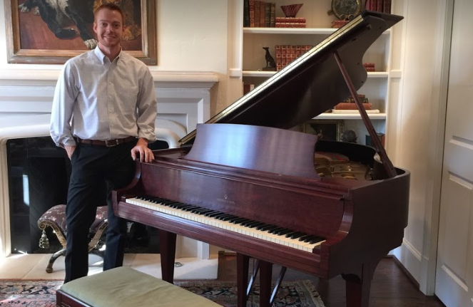 owner with restored piano in home
