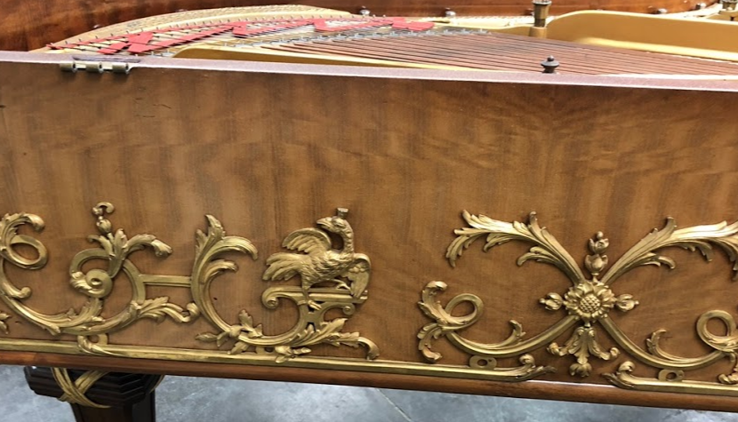 side of piano before restoration