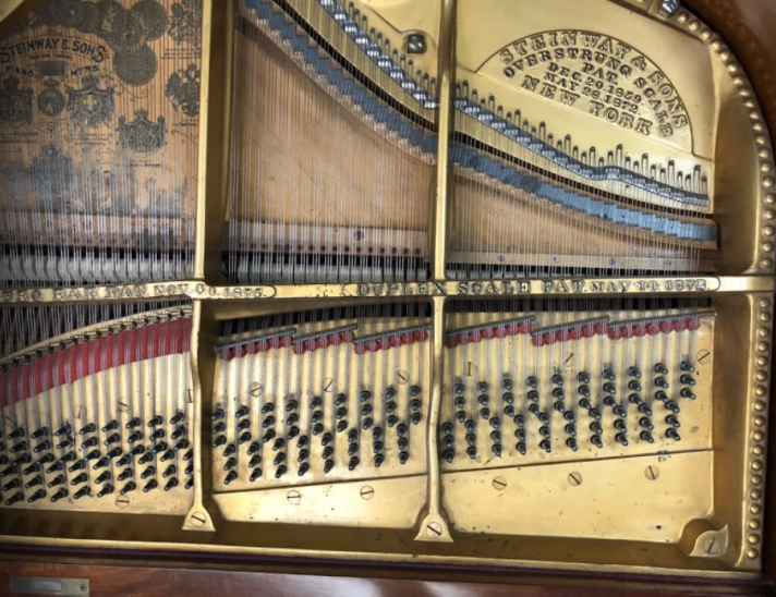 inside of piano before restored